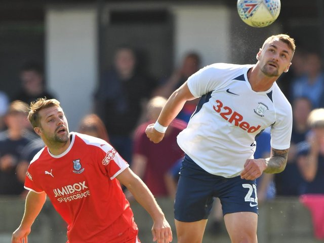 Preston defender Patrick Bauer heads the ball clear with Bamber Bridge's Alistair Waddecar in close attendance during the time the two clubs met