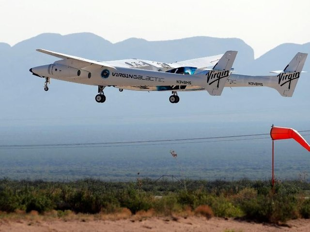 The rocket plane carrying Virgin Galactic founder Richard Branson and other crew members