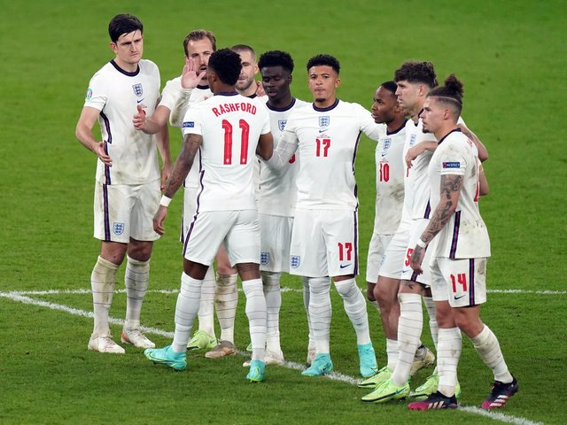 England's Marcus Rashford stands dejected with team mates after missing from the penalty spot during the penalty shoot out following the UEFA Euro 2020 Final at Wembley Stadium, London.