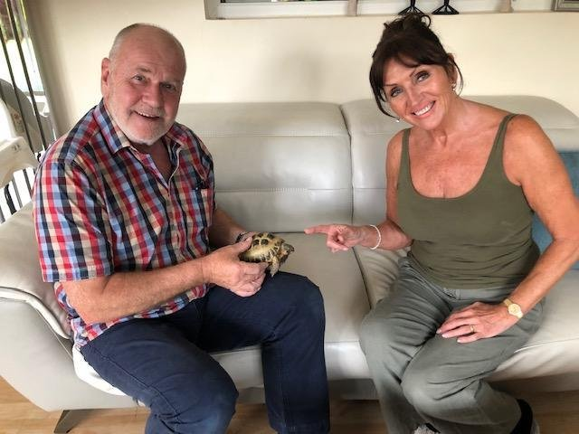 Liz and Stephan Ashby with their beloved pet tortoise, Tom