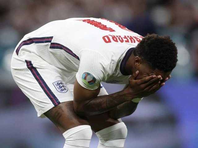 Marcus Rashford reacts after missing his penalty