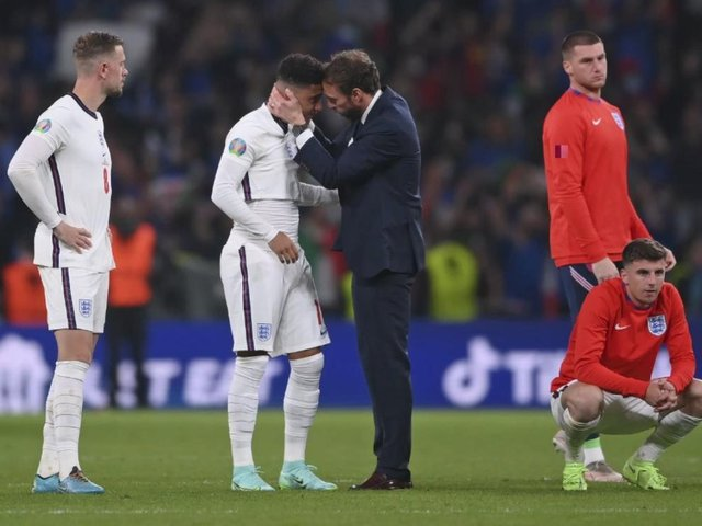 Jadon Sancho is comforted by manager Gareth Southgate after the penalty shoot-out nightmare at Wembley.