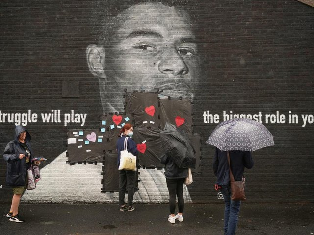 People start to cover the racist graffiti on Marcus Rashford's mural with messages of love in Withington