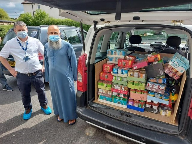 Coun Martyn Rawlinson and Siad Ugradar load up donations from the Boulevard community.