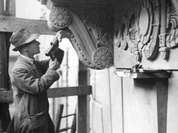 Sculptor at work on Preston Town Hall  in 1932