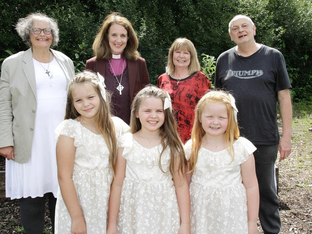 Bishop Jill (back row centre left) and Sharon Collins (back row centre right), are pictured with the baptism and confirmation candidates