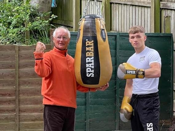 Bob gives grandson Louis some tips in the garden gym.