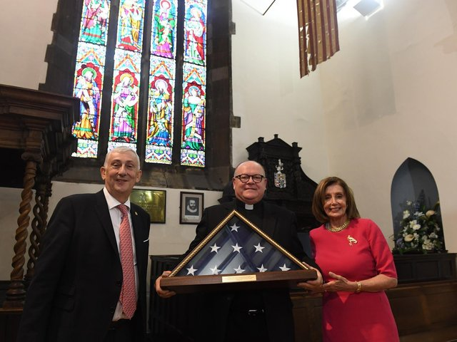 Sir Lindsay Hoyle with rector of St Laurence's Church, Chorley, the Father Neil Kelley, receiving an American flag from Nancy Pelosi, Speaker of the US House of Representatives during the G7 Speakers Conference in Chorley. Photo: Jessica Taylor