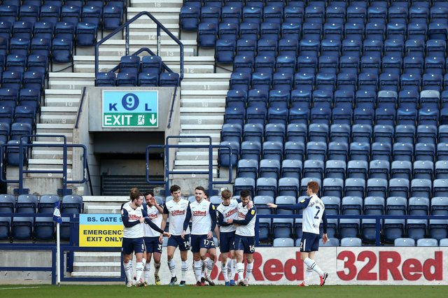 PRESTON, ENGLAND - FEBRUARY 27: Ched Evans of Preston North End celebrates with his team mates in front of empty seats after scoring his team's second goal during the Sky Bet Championship match between Preston North End and Huddersfield Town at Deepdale on February 27, 2021 in Preston, England. Sporting stadiums around the UK remain under strict restrictions due to the Coronavirus Pandemic as Government social distancing laws prohibit fans inside venues resulting in games being played behind closed doors. (Photo by Charlotte Tattersall/Getty Images)