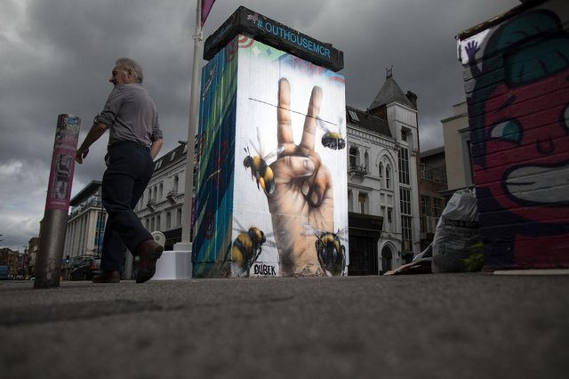 A mural of the worker bee, by artist Russell Meeham, also know as Qubek, adorns the side of a building in Manchester's northern quarter (Getty Images)